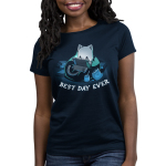 Best Day Ever Women's t-shirt model TeeTurtle navy t-shirt featuring a cat in a bean bag chair holding a portal video game with snacks and books around him