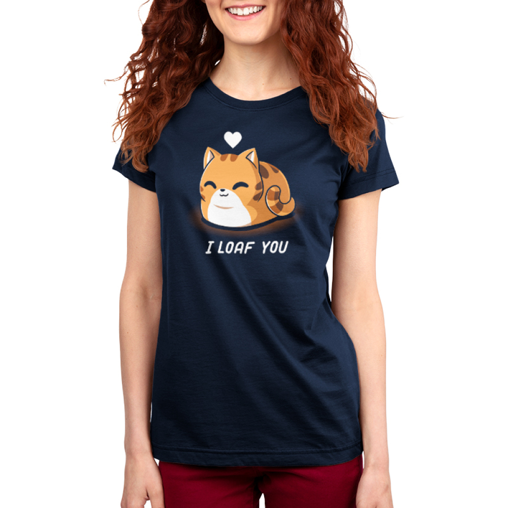 I Loaf You Women's t-shirt model TeeTurtle navy t-shirt featuring a smiling orange tabby cat sitting down with its tail curled around it and its paws tucked underneath it with a white heart floating above its head.