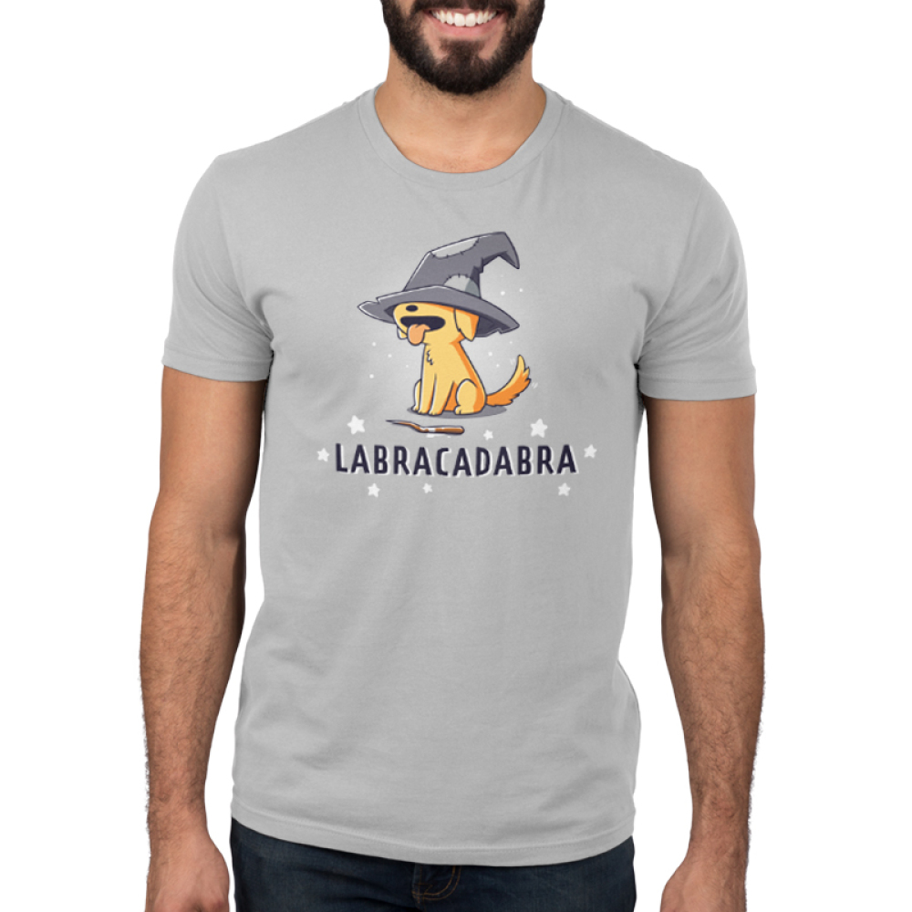 Labracadabra Men's t-shirt model TeeTurtle silver t-shirt featuring a yellow lab smiling with its tongue out wearing a bit witch hat covering its eyes with a stick in front of him and stars all around him