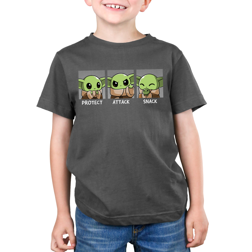 Protect, Attack, Snack Kid's t-shirt model TeeTurtle charcoal t-shirt featuring The Child from The Mandalorian in three poses: a protective stance where he's holding his hands together, an aggressive stance where he's holding out one hand, and a snacking stance where he's happily holding a frog.