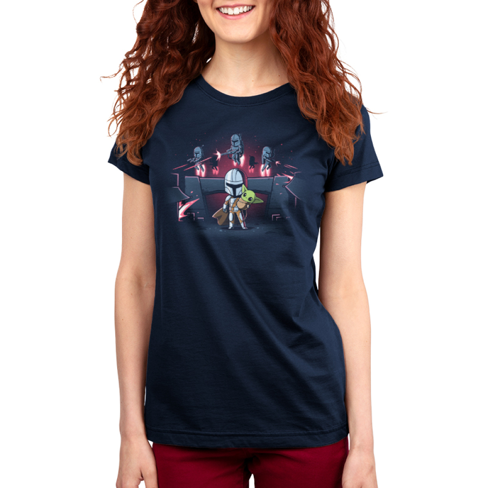 The Mandalorians Women's t-shirt model officially licensed navy Star Wars t-shirt featuring Mando holding The Child with other Mandalorians flying behind them shooting guns