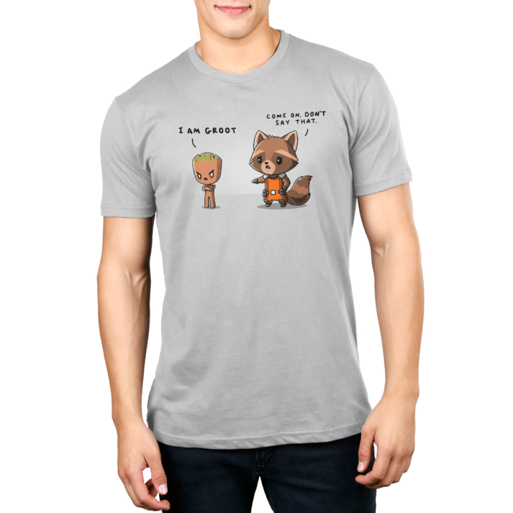 Rocket & Groot Men's t-shirt model officially licensed silver Marvel t-shirt featuring Rocket Raccoon and Groot from Guardians of the Galaxy with a toddler-sized, angrily pouting Groot standing to the righthand side with his arms crossed and a concerned Rocket Raccoon standing to the lefthand side reaching out to Groot.