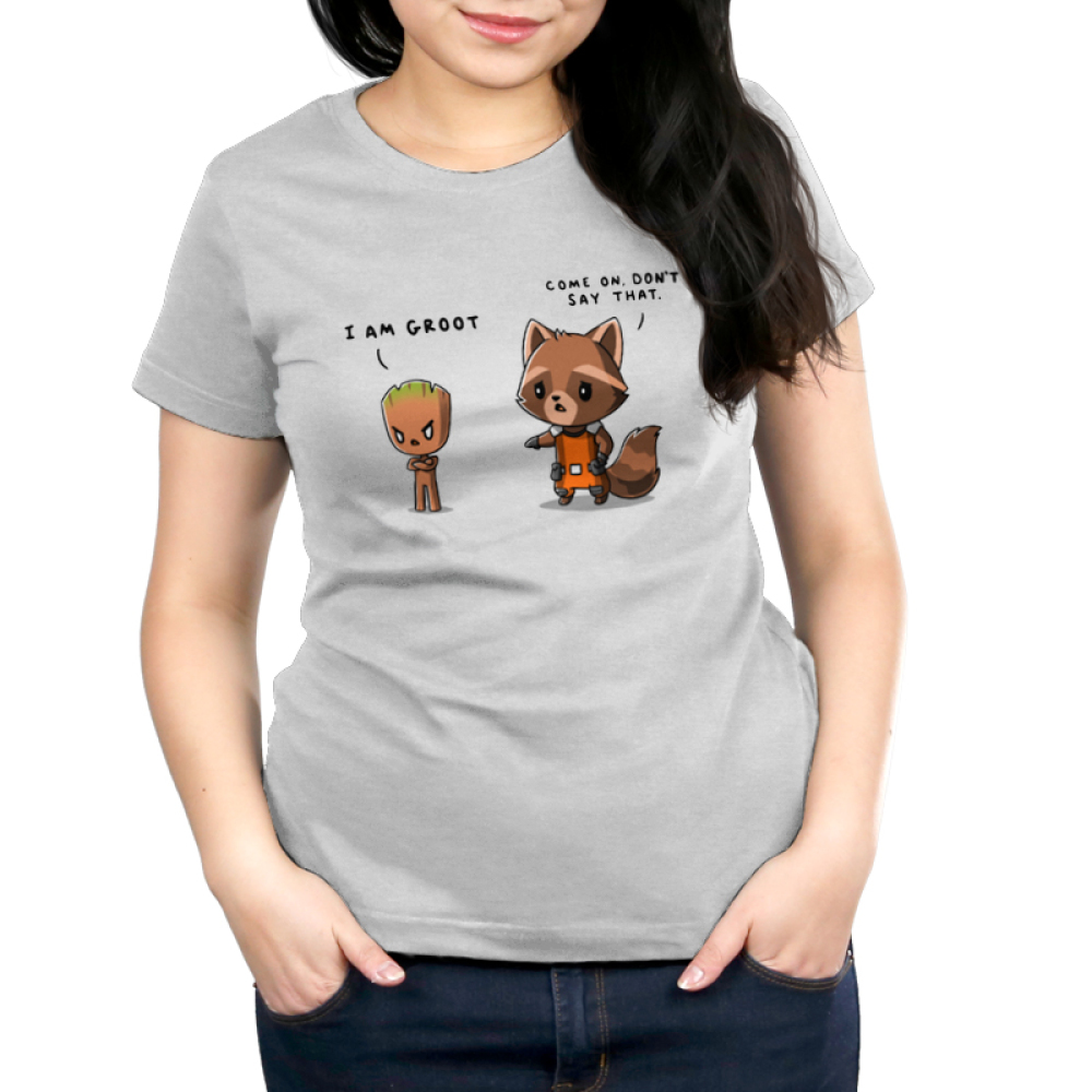 Rocket & Groot Women's t-shirt model officially licensed silver Marvel t-shirt featuring Rocket Raccoon and Groot from Guardians of the Galaxy with a toddler-sized, angrily pouting Groot standing to the righthand side with his arms crossed and a concerned Rocket Raccoon standing to the lefthand side reaching out to Groot.