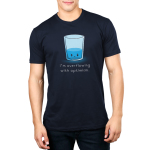 I'm Overflowing with Optimism Men's t-shirt model TeeTurtle navy t-shirt featuring an angry looking water glass with water about 1/3rd the way filled up