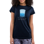I'm Overflowing with Optimism Junior's t-shirt model TeeTurtle navy t-shirt featuring an angry looking water glass with water about 1/3rd the way filled up
