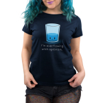 I'm Overflowing with Optimism Women's t-shirt model TeeTurtle navy t-shirt featuring an angry looking water glass with water about 1/3rd the way filled up