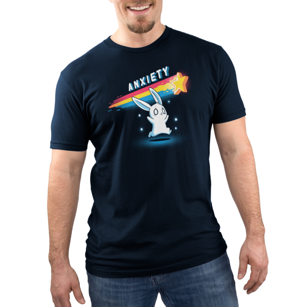 Anxious Bunny Men's t-shirt model TeeTurtle navy t-shirt featuring a panicked looking white bunny running after a yellow star with a rainbow tail trailing behind it