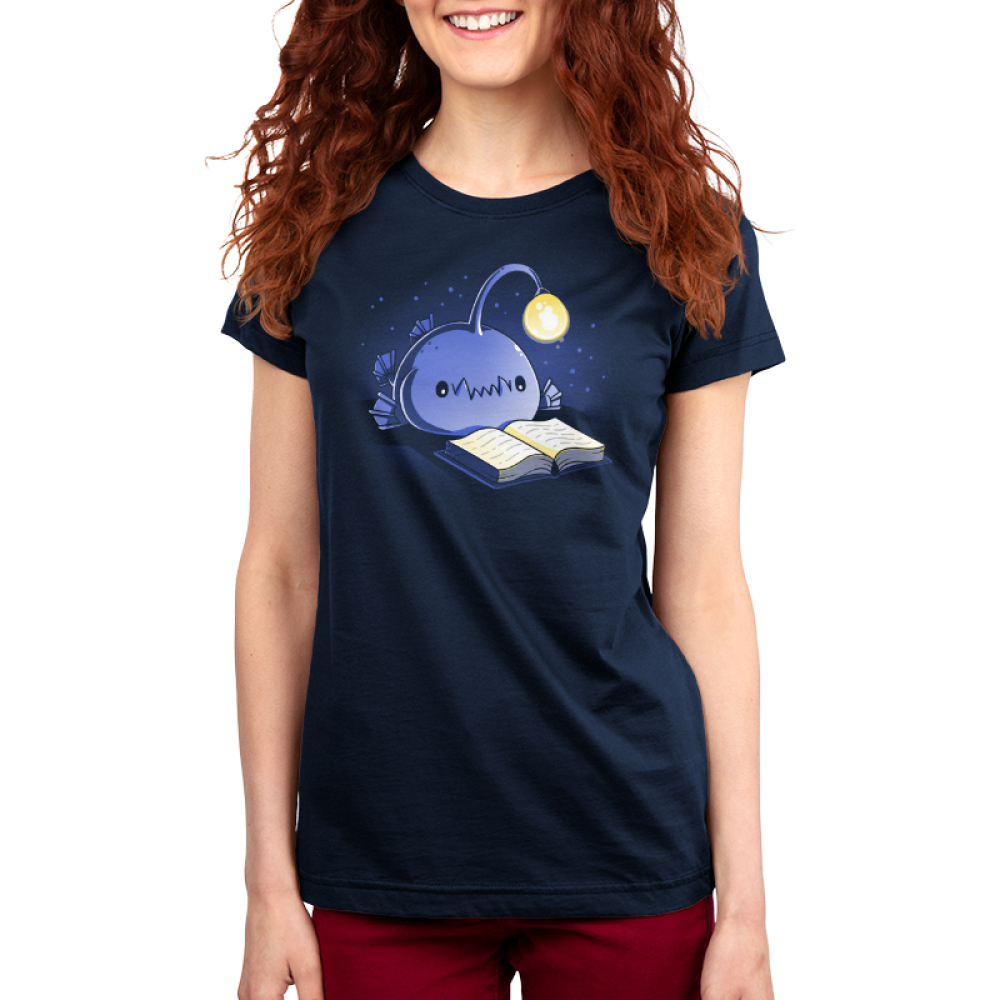 Reading Anglerfish Women's t-shirt model TeeTurtle navy t-shirt featuring a blue anglerfish with its light glowing reading a book