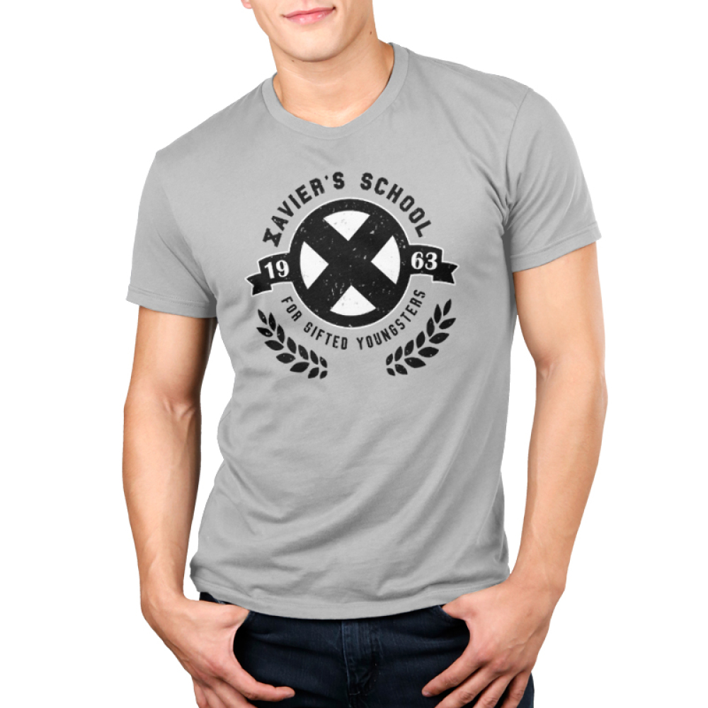 Xavier's School for Gifted Youngsters Men's t-shirt model officially licensed silver Marvel t-shirt featuring a black X in a black circle with two separate ends of a banner on the sides, and black laurel leaves cupping the bottom of the circle.