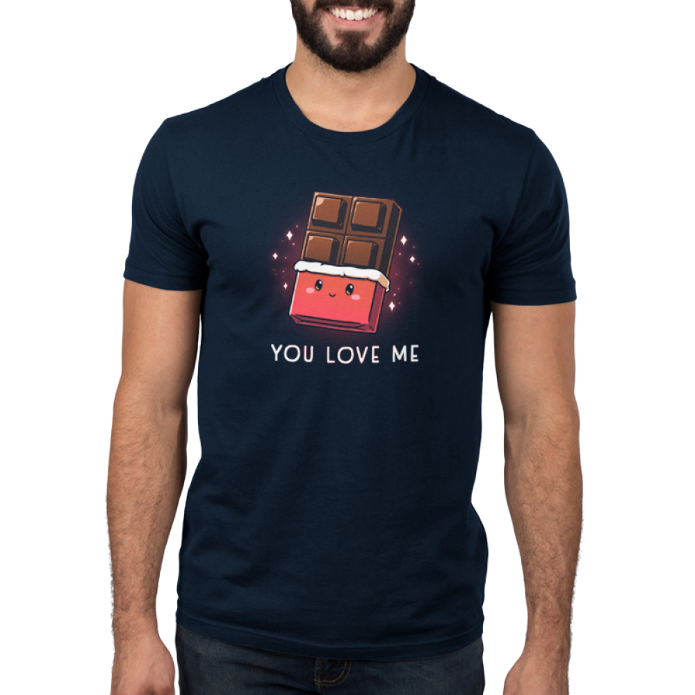 You Love Me Men's t-shirt model TeeTurtle navy t-shirt featuring a chocolate bar with the wrapper rolled down 2/3rds the way down with a cute smiling face on the wrapper and sparkles behind it