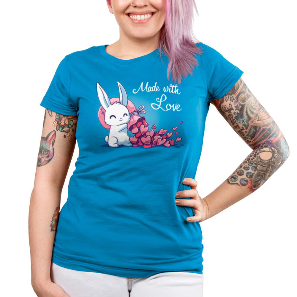 Made With Love Junior's t-shirt model TeeTurtle cobalt blue t-shirt featuring a white bunny holding a big pink sack over its shoulder with tons of pink hearts flowing out of it