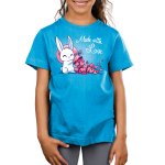 Made With Love Kid's t-shirt model TeeTurtle cobalt blue t-shirt featuring a white bunny holding a big pink sack over its shoulder with tons of pink hearts flowing out of it