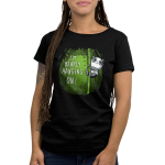 I'm Bearly Hanging On Women's t-shirt model TeeTurtle black t-shirt featuring an anxious panda hanging onto the middle portion of a bamboo shoot in a verdant green bamboo forest.