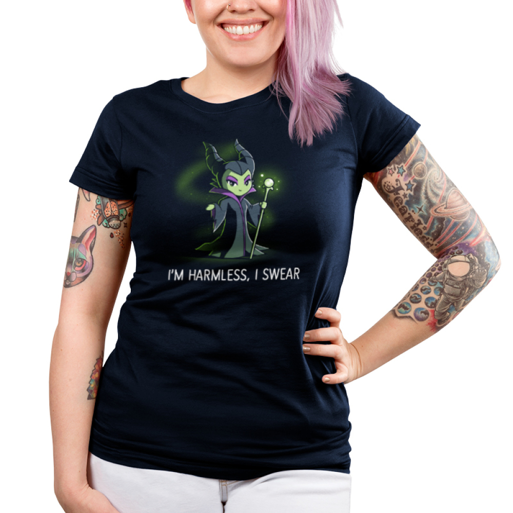 I'm Harmless, I Swear Junior's t-shirt model officially licensed navy Disney t-shirt featuring Maleficent from Sleeping Beauty smiling dangerously, holding a green staff with a green crystal on top, and with green magical, sparkling mist in the background.