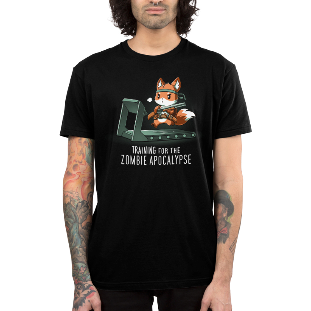Training for the Zombie ApocalypseMen's t-shirt model TeeTurtle black t-shirt featuring an orange fox running on a treadmill while wearing a bandana and utility belt, and holding a shotgun.