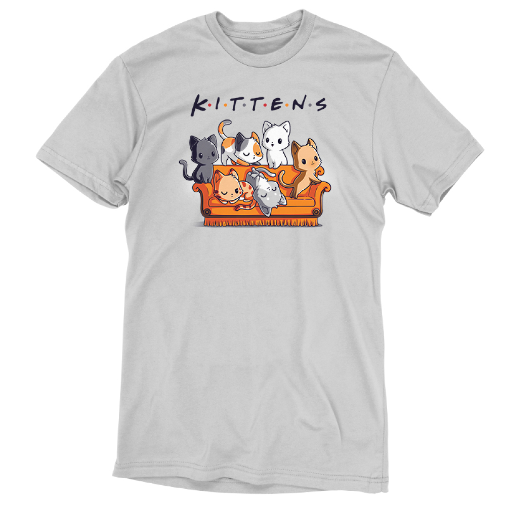 Kittens t-shirt TeeTurtle silver t-shirt featuring six cats on an orange couch, one charcoal cat, one calico cat, one white cat, one orange cat, one light gray and white cat, and one orange stripped cat all laying and crawling over the couch