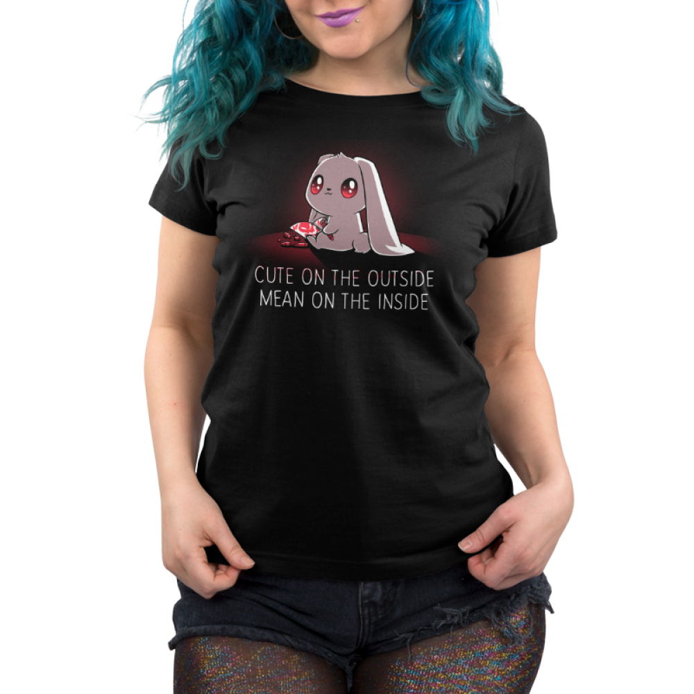 Cute on the Outside, Mean on the Inside Women's t-shirt model TeeTurtle black t-shirt featuring a white bunny with wide, crazy, red eyes and an innocent expression holding a red crayon and a red skull drawing with broken red crayons on the floor.
