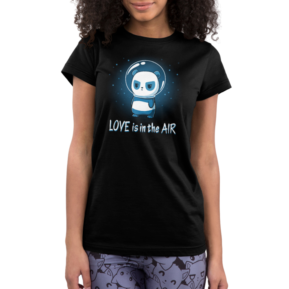 Love is in the Air Junior's t-shirt model TeeTurtle black t-shirt featuring a panda in space with stars in the background with a glass astronaut helmet on looking upset