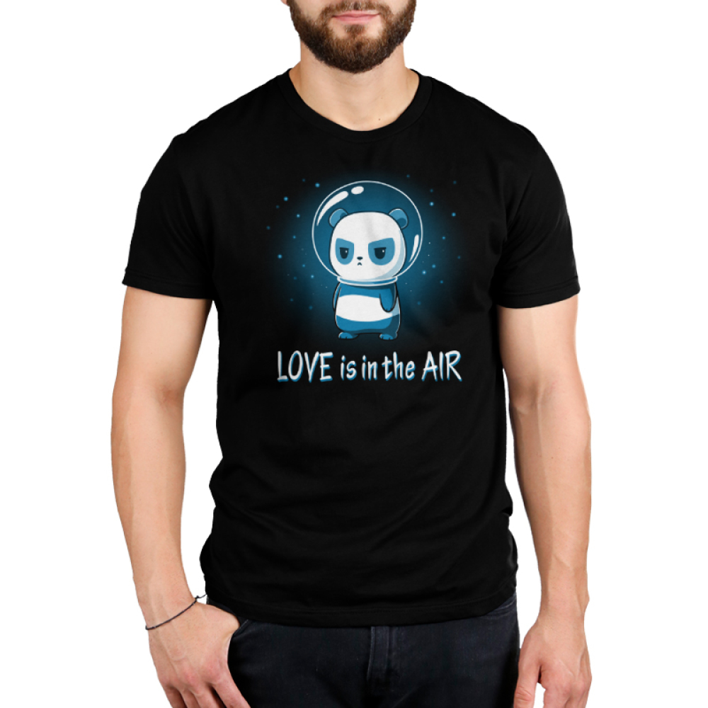Love is in the Air Men's t-shirt model TeeTurtle black t-shirt featuring a panda in space with stars in the background with a glass astronaut helmet on looking upset