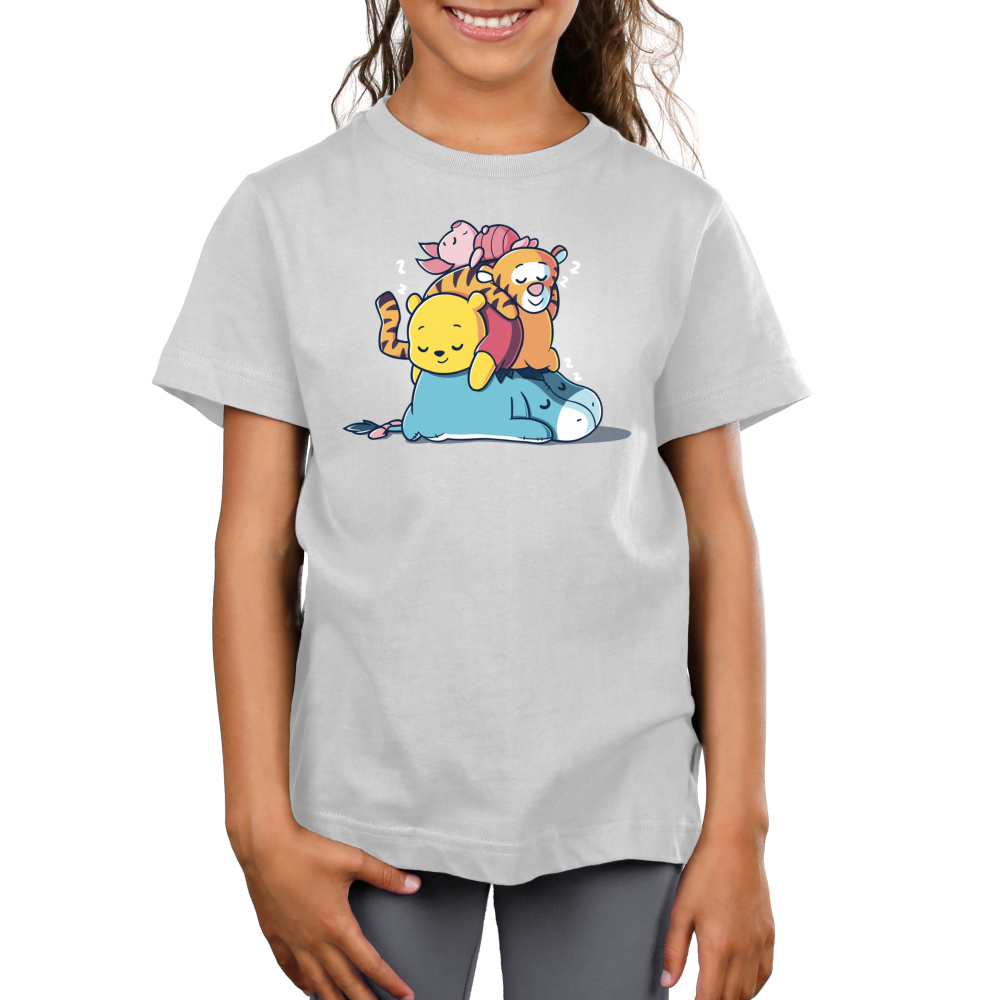 Hard at Work Kid's t-shirt model officially licensed silver Disney t-shirt featuring Eeyore laying on the floor sleeping with Pooh, Tiger, and Piglet all also sleeping piled on top of him
