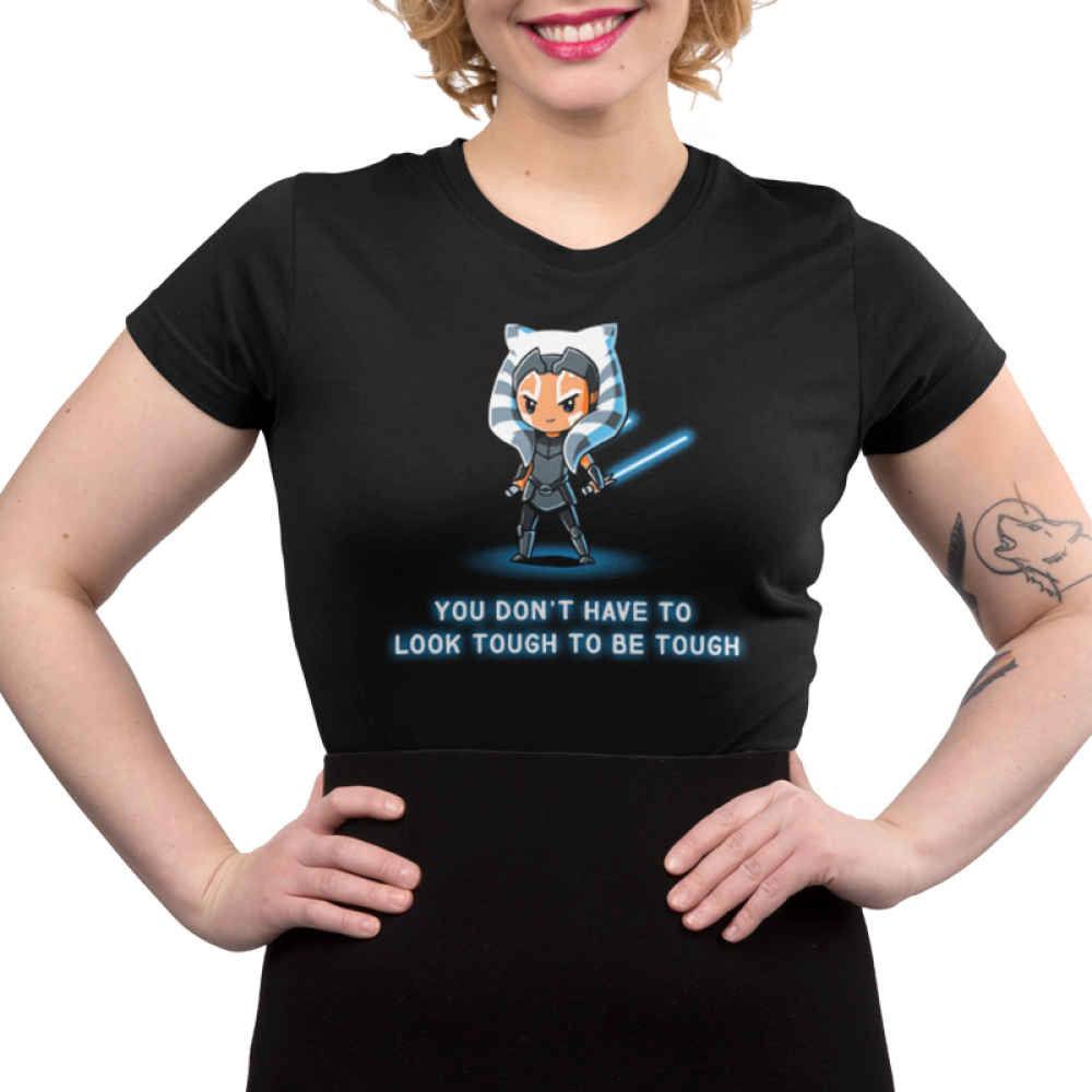 You Don't Have To Look Tough To Be Tough Junior's t-shirt model officially licensed black Star Wars t-shirt featuring Ahsoka Tano standing with both of her blue lightsabers in hand