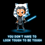 You Don't Have To Look Tough To Be Tough t-shirt officially licensed black Star Wars t-shirt featuring Ahsoka Tano standing with both of her blue lightsabers in hand