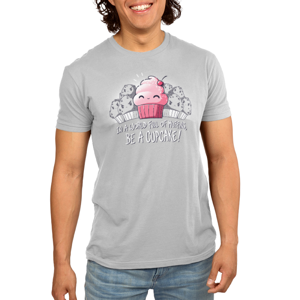 Be a Cupcake Men's t-shirt model TeeTurtle silver t-shirt featuring a pink smiling cupcake with a bunch of grayed out angry looking muffins behind him