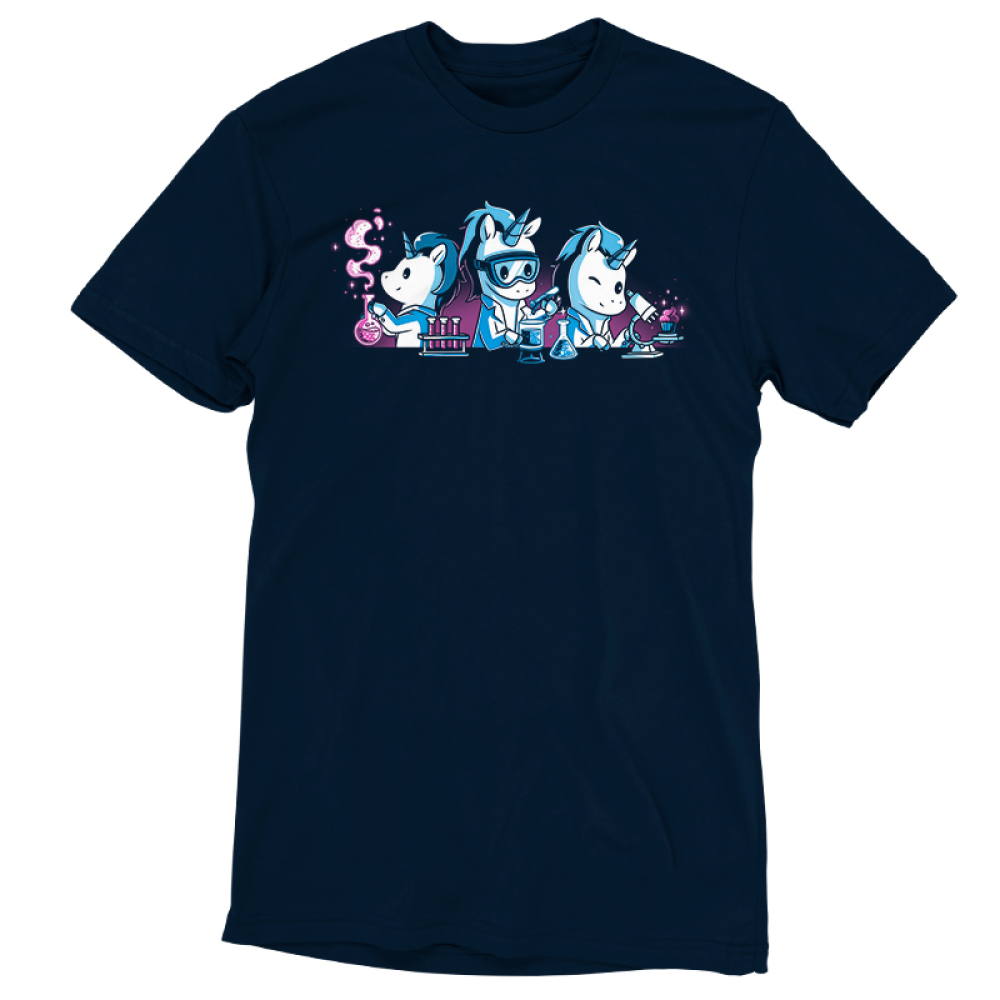 Unicorn Scientists navy t-shirt featuring three white unicorns with blue manes in white lab coatssurrounded by lab equipment, with the lefthandunicorn holding a smoking beaker, the middle unicornpouring a test tubeinto a beaker, and the righthand unicorn inspecting a pink cupcake under a microscope.