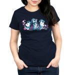 Unicorn Scientists Women's t-shirt model TeeTurtle navy t-shirt featuring three white unicorns with blue manes in white lab coatssurrounded by lab equipment, with the lefthandunicorn holding a smoking beaker, the middle unicornpouring a test tubeinto a beaker, and the righthand unicorn inspecting a pink cupcake under a microscope.
