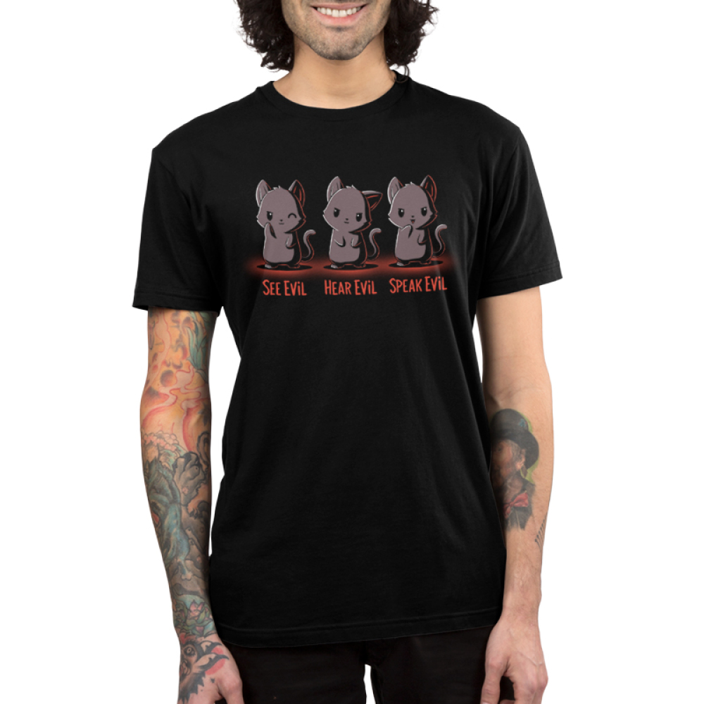 See Evil, Hear Evil, Speak Evil Men's t-shirt model TeeTurtle black t-shirt featuring a gray cat on the left pointing a paw at its eye, a gray cat in the middle with its ear cocked to the side, and a gray cat on the right pointing a paw at its mouth.