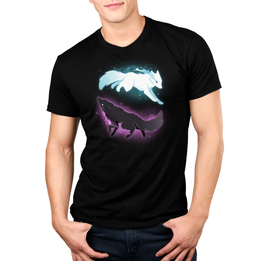 Celestial Spirits Men's t-shirt model TeeTurtle black t-shirt featuring a white wolf with blue sparkles on the top running to the righthand side and a black wolf with purple sparkles on the bottom running to the lefthand side in such a way that they form a circle.