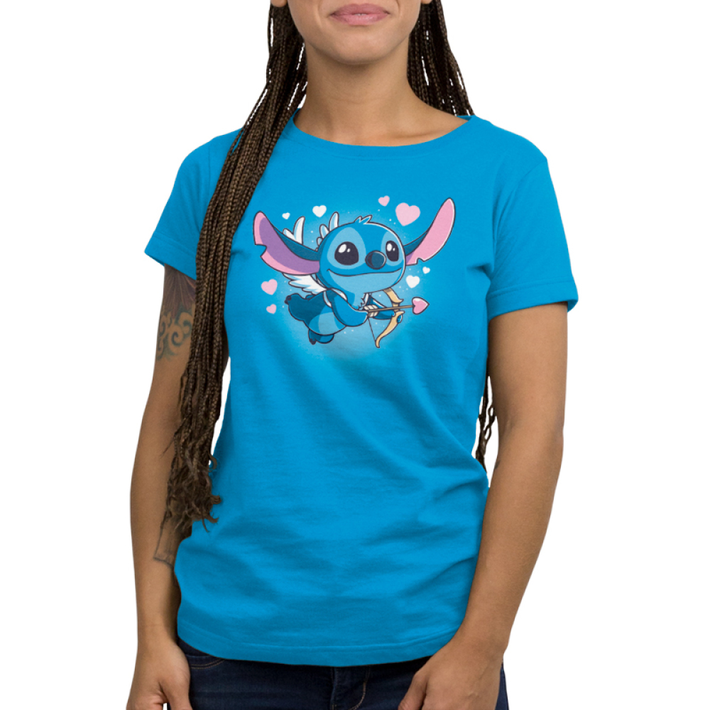 Cupid Stitch Women's t-shirt model officially licensed cobalt blue Disney t-shirt featuring stitch with white wings flying with a cupids arrow and hearts around him