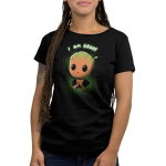 Pouting Groot Women's t-shirt model officially licensed black Marvel t-shirt featuring little Groot sitting down looking up looking sad with his eyes so big