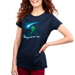 When You Wish Upon a Star Women's t-shirt model TeeTurtle navy t-shirt featuring a little green t-rex on a grassy hilltop looking happily up at a shooting star against a starry sky.