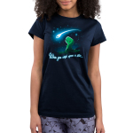When You Wish Upon a Star Junior's t-shirt model TeeTurtle navy t-shirt featuring a little green t-rex on a grassy hilltop looking happily up at a shooting star against a starry sky.
