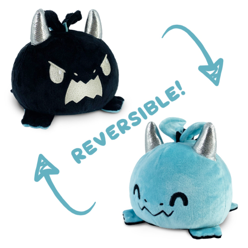 Reversible Dragon Plushie featuring an angry black dragon with silver horns that flips to a happy blue dragon with silver horns.