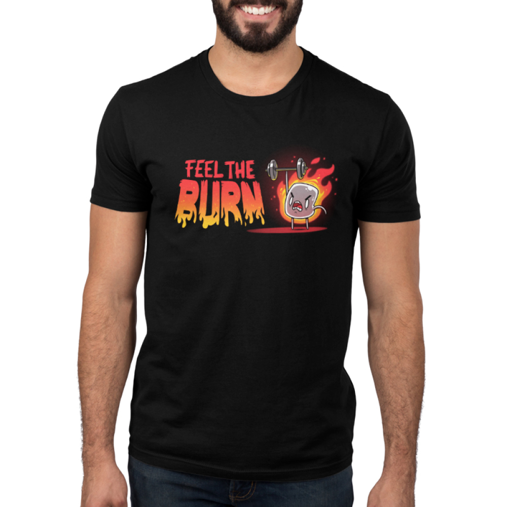 Feel the Burn Men's t-shirt model TeeTurtle black t-shirt featuring a crazy looking marshmallow on fire lifting a weight with one arm