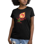 Meteor Destroyer Women's t-shirt model TeeTurtle black t-shirt featuring a tiny green tyrannosaurus rex wearing a shield and sword on top of a hill roaring at a gigantic incoming meteor that's bathing the surrounding jungle in red light.
