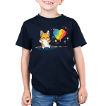Paw Painting (Corgi) Kid's t-shirt model TeeTurtle navy t-shirt featuring a corgi sitting up covered in multiple paint colors beside a rainbow heart with colorful pawprints and splatters all around.
