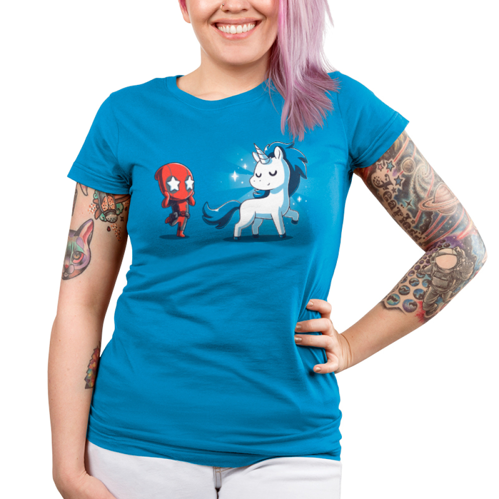 Deadpool's Magical Friend Junior's t-shirt model officially licensed cobalt blue Marvel t-shirt featuring Deadpool looking in awe with stars over his eyes looking at a white and blue unicorn with sparkles around it