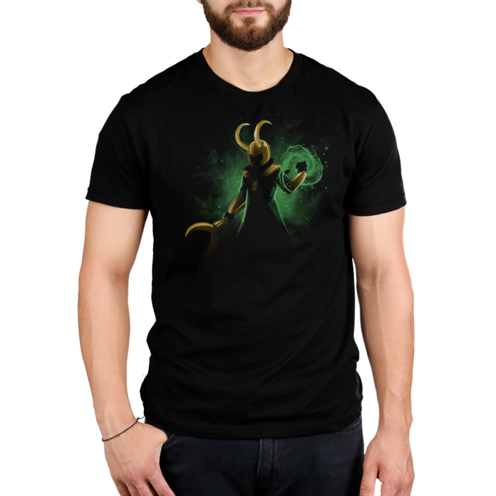 God of Mischief Men's t-shirt model officially licensed black Marvel t-shirt featuring Loki in the shadows with his gold helmet and staff with a green swirl of power forming around his other hand with a green galaxy behind him