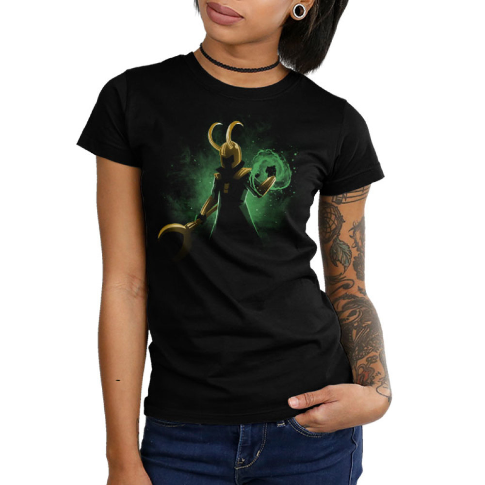 God of Mischief Junior's t-shirt model officially licensed black Marvel t-shirt featuring Loki in the shadows with his gold helmet and staff with a green swirl of power forming around his other hand with a green galaxy behind him