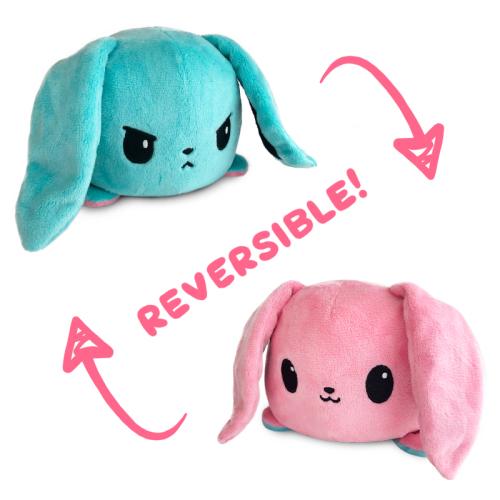 An angry aqua reversible bunny plushie flipping to a happy pink reversiblebunny plushie.