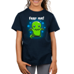 Fear Me! Kid's t-shirt model TeeTurtle navy t-shirt featuring a cute child-sized Cthulhu with stars in its eyes standing while raising its arms against a background of blue stars.