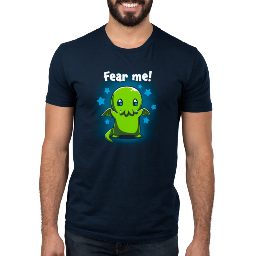 Fear Me! Men's t-shirt model TeeTurtle navy t-shirt featuring a cute child-sized Cthulhu with stars in its eyes standing while raising its arms against a background of blue stars.
