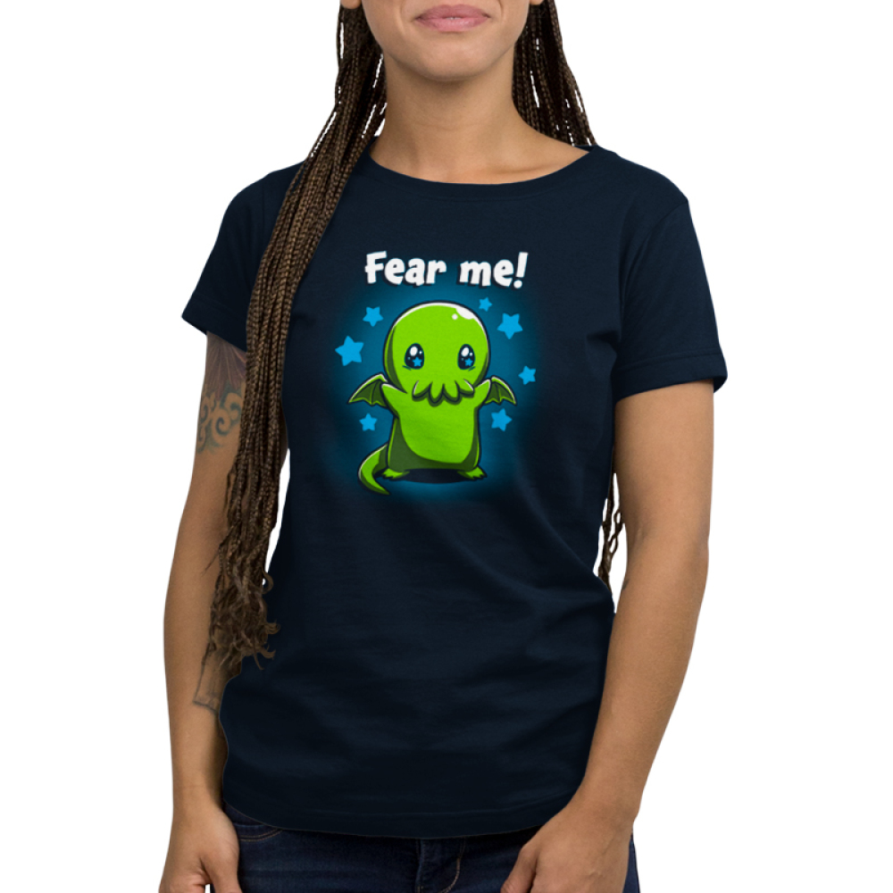 Fear Me! Women's t-shirt model TeeTurtle navy t-shirt featuring a cute child-sized Cthulhu with stars in its eyes standing while raising its arms against a background of blue stars.