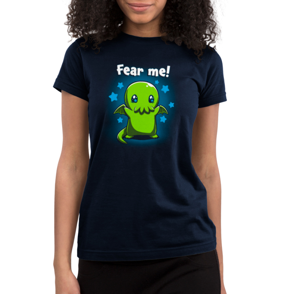 Fear Me! Junior's t-shirt model TeeTurtle navy t-shirt featuring a cute child-sized Cthulhu with stars in its eyes standing while raising its arms against a background of blue stars.