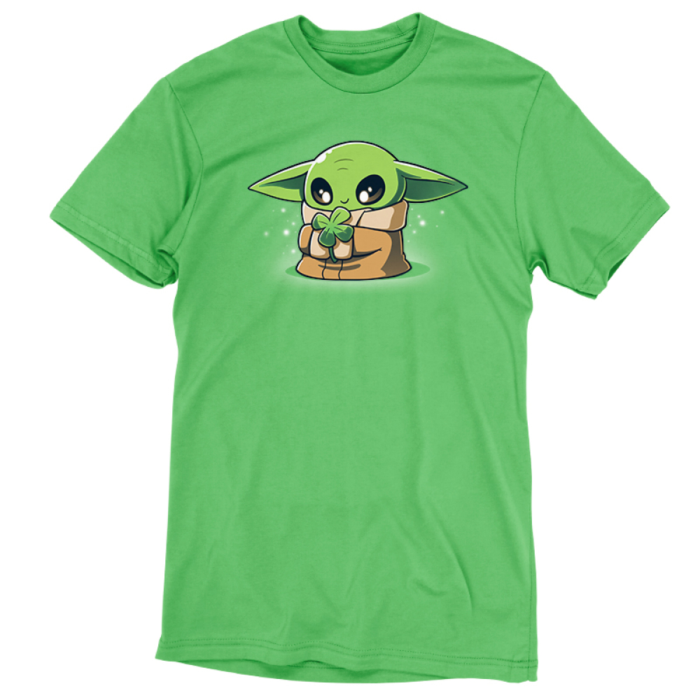 Lucky Grogu t-shirt officially licensed apple green Star Wars t-shirt featuring Grogu from the Mandalorian where he is smiling and holding a four leaf clover