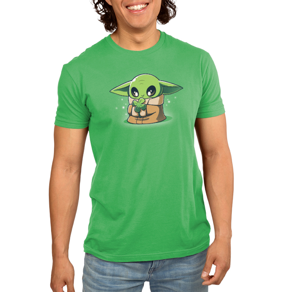 Lucky Grogu Men's t-shirt model officially licensed apple green Star Wars t-shirt featuring Grogu from the Mandalorian where he is smiling and holding a four leaf clover
