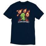 It's My Lucky Daynavy t-shirt featuring a smiling green tyrannosaurus rex holding a four-leaf clover with a meteor shower in the background.